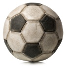 Detail of a old black and white soccer ball isolated on white background