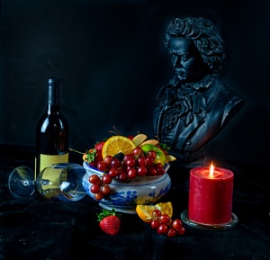 Still life with fruit and a glass of wine candle and beethoven
